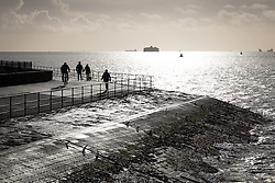© Licensed to London News Pictures. 28/12/2013. Portsmouth, UK People out enjoying the morning sunshine after the recent stormy weather. Photo credit : Rob Arnold/LNP