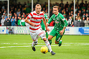 Celtic FC Forward Leigh Griffiths and Hamilton Academical Midfielder Grant Gillespie battling  during the Ladbrokes Scottish Premiership match between Hamilton Academical FC and Celtic at New Douglas Park, Hamilton, Scotland on 4 October 2015. Photo by Craig McAllister.
