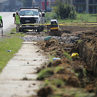Workers with Eubanks Construction get ready to move to another spot as they work to install new sewer lines along Ida Street Tuesday morning.