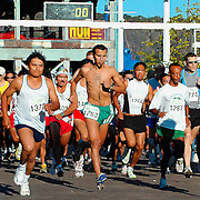Runners sprint forward at the start of the Annual Yonkers marathon; Sept, 2005.