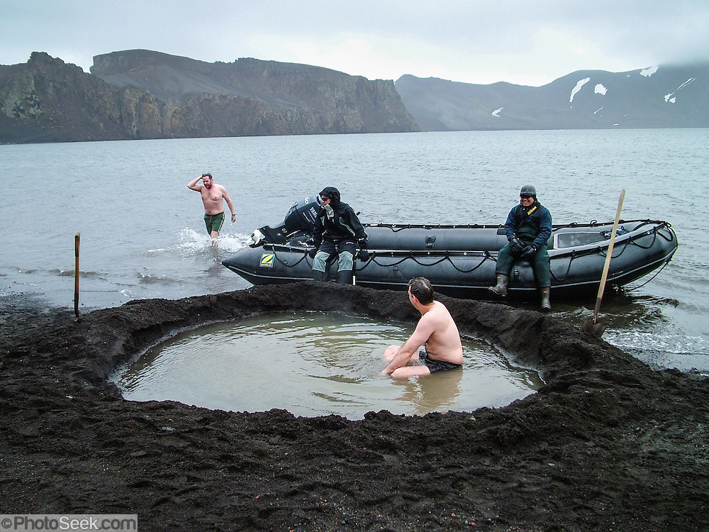 On Deception Island, a hot spring percolates into a black sand beach pool on Whaler's Bay, great for soaking on a cold day. In the South Shetland Islands near the Antarctic Peninsula, Deception Island has one of the safest harbors in Antarctica. Deception Island is the caldera of an active volcano, which caused serious damage to local scientific stations in 1967 and 1969. The island is now a tourist destination and scientific outpost, with research bases run by Argentina and Spain. The island is administered under the Antarctic Treaty System. The sea surrounding Deception Island is closed by ice from early April to early December.
