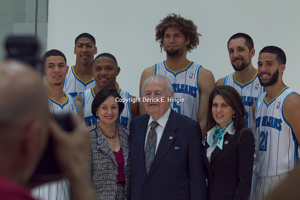 October 1, 2012; Westwego, LA, USA; Photographer John McCusker of the New Orleans Advocate takes a portrait of New Orleans Saints and New Orleans Hornets owner Tom Benson (center) along with his wife Gayle Benson (left) granddaughter Owner/Vice Chairman of the Board Rita Benson LeBlanc, (right) pose with key Hornets players (left to right) guard Austin Rivers (25), forward Anthony Davis, guard Eric Gordon, center Robin Lopez, forward Ryan Anderson and guard Greivis Vasquez during Media Day at the Alario Center. Mandatory Credit: Derick E. Hingle-US PRESSWIRE