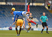 Portsmouth defender Christian Burgess beats Cambridge United Forward Jimmy Spencer to the ball during the Sky Bet League 2 match between Portsmouth and Cambridge United at Fratton Park, Portsmouth, England on 27 February 2016. Photo by Adam Rivers.