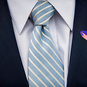 """Mayoral candidate Nathan Fletcher dons his """"I Voted"""" sticker."""
