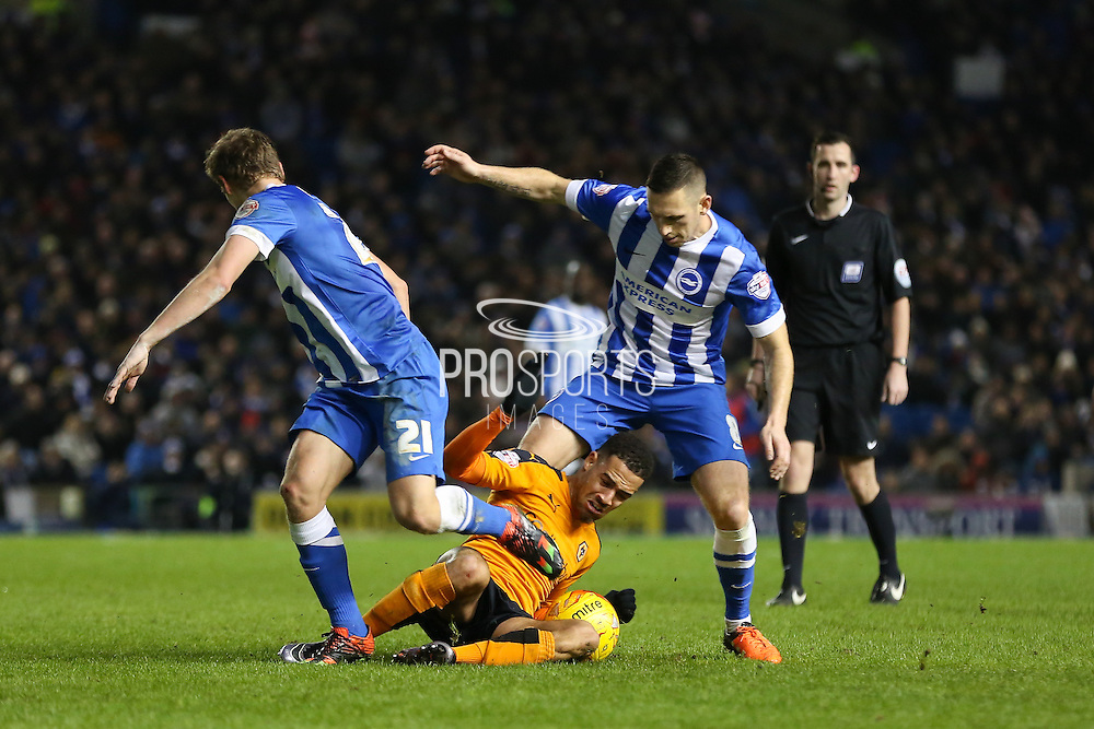 Wolverhampton Wanderers midfielder Jordan Graham (24) battles with Brighton central midfielder, Andrew Crofts (8) during the Sky Bet Championship match between Brighton and Hove Albion and Wolverhampton Wanderers at the American Express Community Stadium, Brighton and Hove, England on 1 January 2016. Photo by Phil Duncan.