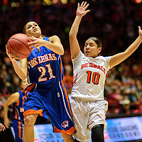 031215  Adron Gardner/Independent<br /> <br /> Los Lunas Tiger Cera Chavez (21) attempts a field goal shadowed by Gallup Bengal Deerae Torrez (10) during a 5A New Mexico state basketball tournament final at The Pit in Albuquerque Thursday.
