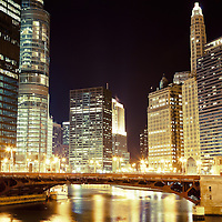 Chicago State Street Bridge at night (Bataan-Corregidor Memorial Bridge)  along the Chicago River with 330 North Wabash (formerly IBM Building), Trump Tower, 333 North Michigan, London Guarantee Building / Crain Communications Building (360 North Michigan) Mather Tower (75 East Wacker Drive), and Hotel 71.
