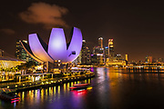 The ArtScience Museum and downtown skyline at night, Singapore, Republic of Singapore