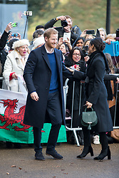 © Licensed to London News Pictures. 18/01/2018. Cardiff, UK. Prince Harry and Meghan Markle arrive at Cardiff Castle, to visit the Wales Culture Fair. Photo credit : Tom Nicholson/LNP