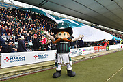 Plymouth Argyle mascott Pilgrim Pete stands in front of the fans as they pass a giant flag along the stand before the EFL Sky Bet League 1 match between Plymouth Argyle and Accrington Stanley at Home Park, Plymouth, England on 22 December 2018.