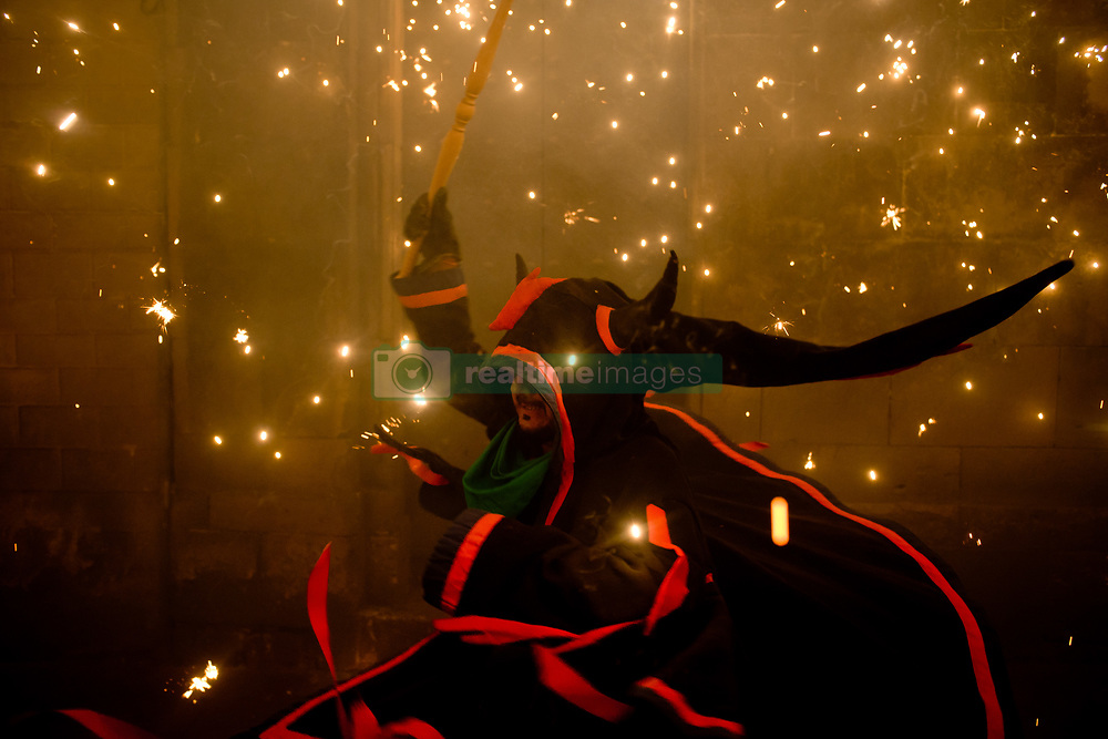 August 16, 2017 - Barcelona, Catalonia, Spain - A man dressed as a devil runs amidst the pyrotechnics during the celebration of Sant Roc Festival in Barcelona. Correfocs, an old Catalan tradition where people dressed as devils blow up firecrackers and flares, take part every August in the celebrations for the Sant Roc Festival in the Gothic Quarter of Barcelona. (Credit Image: © Jordi Boixareu via ZUMA Wire)