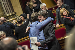 Carles Puigdemont, former premier of Catalonia and Oriol Junqueras, former Vice-President of Catalonia, celebrate at the Generalitat de Catalunya on October 27, 2017, in Barcelona, Spain. Members of the Catalan Parliament voted for independence following a two-day session on how to respond the Spanish government's enacting of Article 155, which would curtail Catalan autonomy. Photo by Almagro/ABACAPRESS.COM