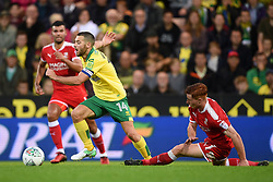 Norwich City's Wes Hoolahan (left) and Swindon Town's Tom Smith (right) battle for the ball during the Carabao Cup, first round match at Carrow Road, Norwich.