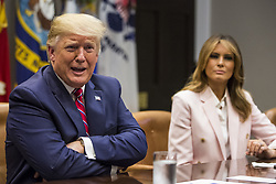 U.S. President Donald Trump speaks during an opioid round table at the White House in Washington, DC, USA, 12 June 2019. At right is U.S. First Lady Melania Trump. Photo by Zach Gibson/Pool/ABACAPRESS.COM