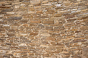Stone wall pattern. Hungo Pavi is a Chacoan great house (monumental public building) occupied AD 1000-1250s and preserved in what is now Chaco Culture National Historical Park. Chaco Canyon hosts the densest and most exceptional concentration of pueblos in the American Southwest and is a UNESCO World Heritage Site. Chaco Canyon is in remote northwestern New Mexico, between Albuquerque and Farmington, USA. From 850 AD to 1250 AD, Chaco Canyon advanced then declined as a major center of culture for the Ancient Pueblo Peoples. Chacoans quarried sandstone blocks and hauled timber from great distances, assembling fifteen major complexes that remained the largest buildings in North America until the 1800s. Climate change may have led to its abandonment, beginning with a 50-year drought starting in 1130.
