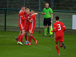 NEWPORT, WALES - Monday, October 14, 2019: Wales' Joshua Thomas (C) celebrates scoring the second goal with team-mates Will Russ (L) and Sam Bowen (R) during an Under-19's International Friendly match between Wales and Austria at Dragon Park. Wales won 2-0. (Pic by David Rawcliffe/Propaganda)