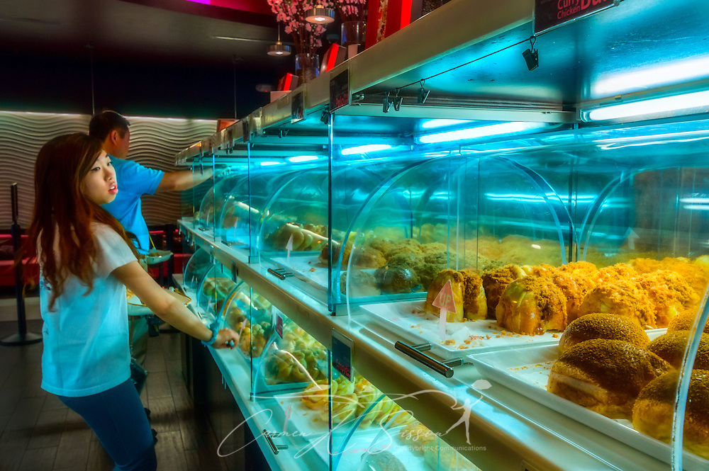 A customer browses the display cases at Sweet Hut Bakery and Cafe, May 29, 2014, in Doraville, Georgia. Sweet Hut, a boutique bakery and bistro, opened in 2012 and caters to the international community, offering more than 200 Asian-inspired delicacies and drinks. Popular items include the Hong Kong Polo Bun and Taiwanese bubble tea. (Photo by Carmen K. Sisson/Cloudybright)