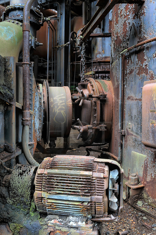 Abandoned and decaying machinery and electrical motor at the Carrie Furnace industrial site near Pittsburgh, PA.