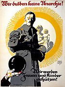German political poster shows a soldier  standing in front of a woman and her children. Text reads: We won't tolerate anarchy! We'll protect women and children': 1919, the year of the Communist  Spartacus riots in Germany.