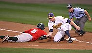 TinCaps catcher Robert Lara (5) dives back into first as Bees first baseman David Wood (22) snags the pickoff attempt in the fourth inning of game three of the Midwest League Championship at Community Field in Burlington, Iowa on September 17, 2009.