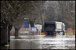 An army truck wades through food water in a residential street in Egham, Surrey, United Kingdom, as floods hit Britain. Thursday, 13th February 2014. Picture by Andrew Parsons / i-Images