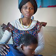 Atlanta, Georgia/Central Africa Republic Refugee/Nestorine Lakas, 27, holds her son Eric who has cerebral palsy, at their apartment in Atlanta. Nestorine arrived in the U.S. in 2010 with her two young children from the Central African Republic. Her son, who is now 7 years old, suffers from severe cerebral palsy and requires a wheelchair and specialized healthcare. At the IRC in Atlanta, Nestorine is part of the Temporary Assistance for Needy Families (TANF) program where she is learning English, job skills and basic computer literacy so she can support her family as a single mom and learn how to manage her son's health needs. Unfortunately the father of Nestorine's children was not able to come to the U.S. with her, so she cares for her children and dreams of reuniting with him someday. Nestorine believes what makes her successful is &quot;working hard and overcoming challenges.&quot; <br />
