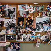A bulletin board with snapshots and memorabilia in the office of George Pelecanos, at his home, in Silver Spring, Maryland.