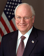 Richard Bruce 'Dick' Cheney (born 1941) served as the 46th Vice-President of the United States 2001-2009 under George W Bush. Head-and-shoulders portrait with stars-and-stripes in background. American Politician Republican