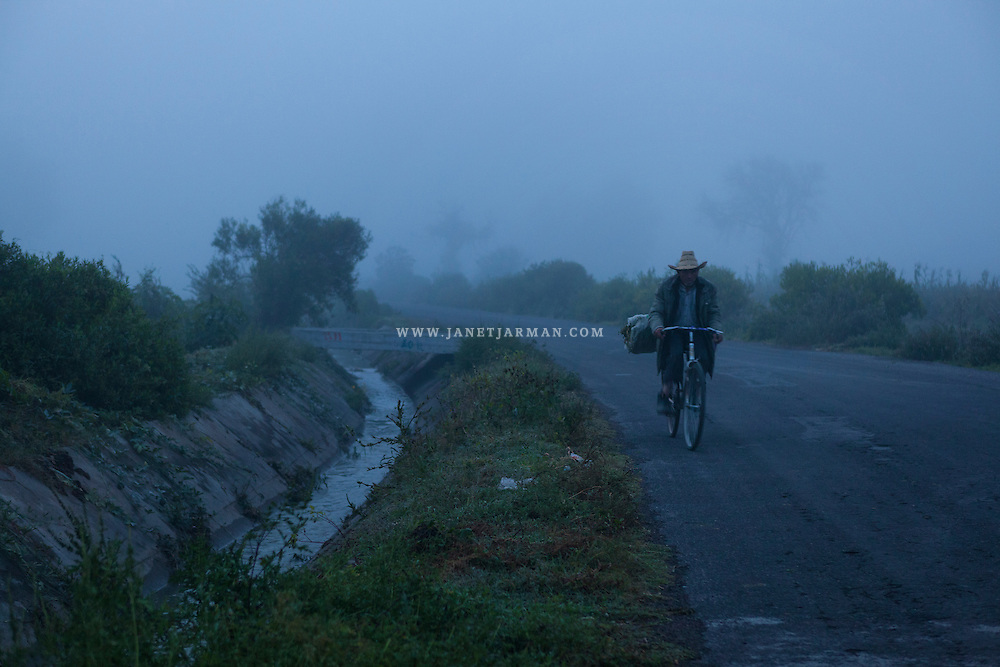 Hilario Hernandez Lozano pedals his bike through fog in the Mezquital Valley of Mexico's Hidalgo state. Stunning pastoral landscapes are common in Hidalgo, a state less well know for tourism but steeped in tradition and history.