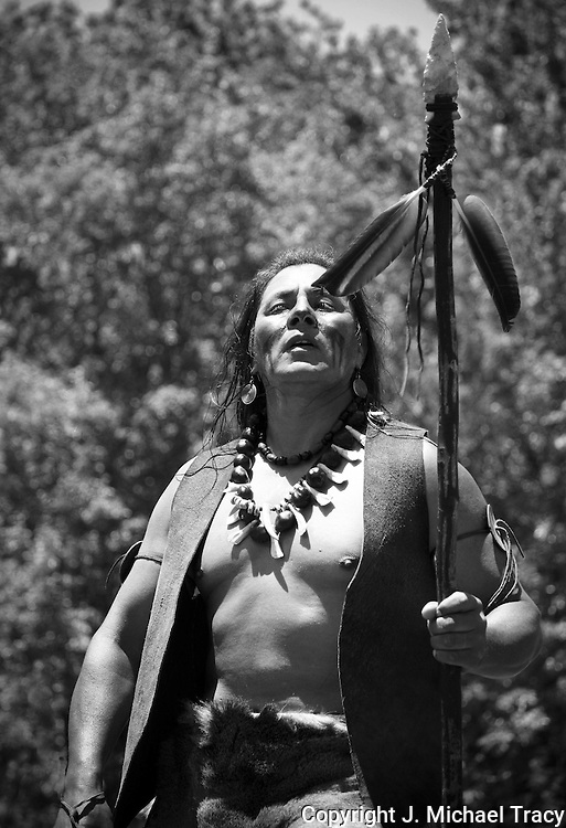 A Native American Warrior engaged in a solemn tribal dance at an Indian Pow Wow, Stone Mountain Georgia.
