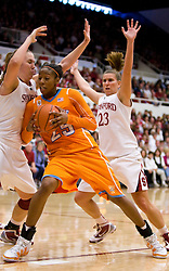 December 19, 2009; Stanford, CA, USA;  Tennessee Lady Volunteers forward Glory Johnson (25) is guarded by Stanford Cardinal forward Kayla Pedersen (14) and guard Jeanette Pohlen (23) during the second half at Maples Pavilion.  Stanford defeated Tennessee 67-52.