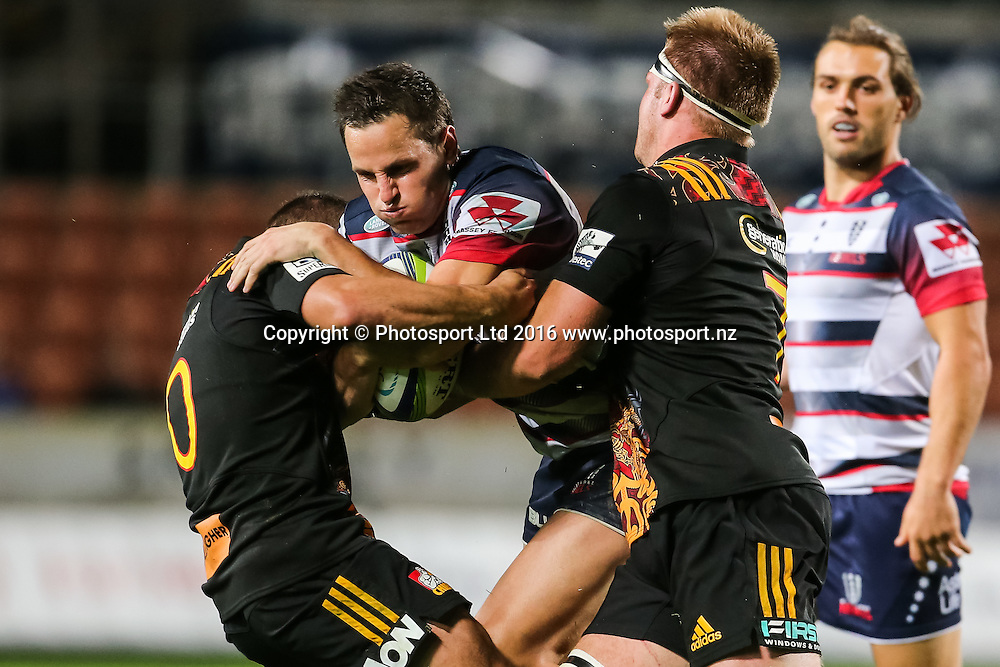 Rebels fullback Mike Harris is tackled during the Super Rugby match - Chiefs v Rebels played at FMG Stadium Waikato, Hamilton, New Zealand on Saturday 21 May 2016. <br /> <br /> Copyright Photo: Bruce Lim / www.photosport.nz