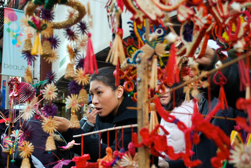 A woman inspects street vendor merchandise during the Chinese New Year celebrations in New York, 2009
