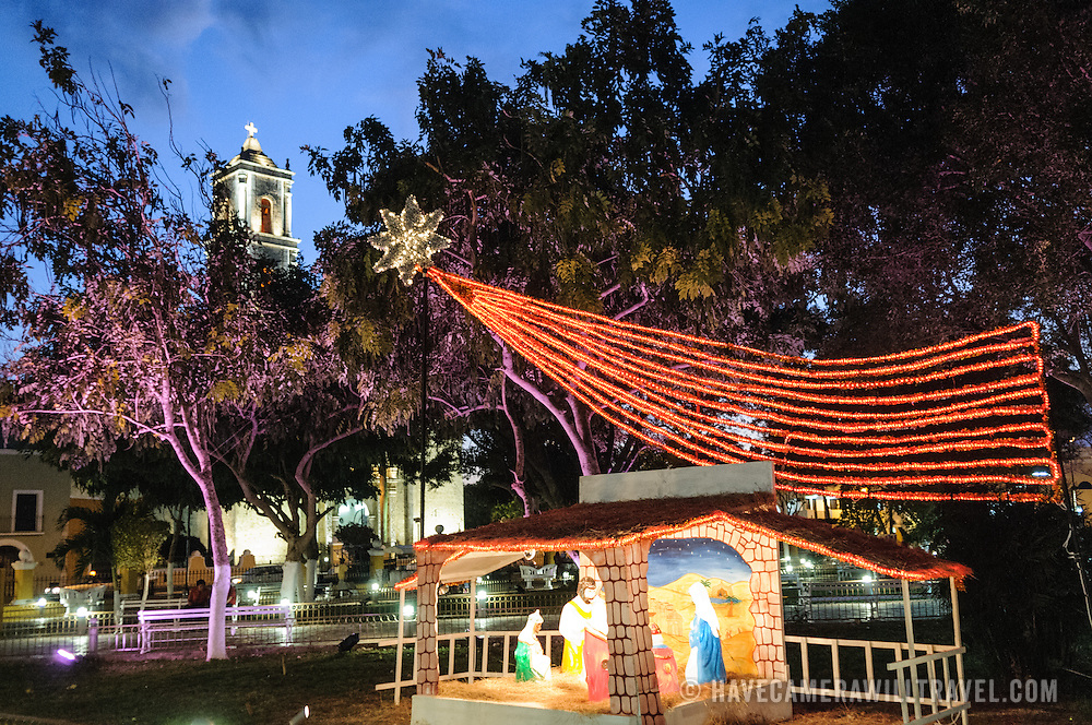 This illuminated Christmas nativity scene was on display in the main square of Valladolid, a colonial town in the center of Mexico's Yucatan Peninsula. In the top right you can see the top of one of the two steeples of the Cathedral of San Gervasio.