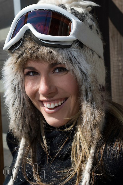 Skier Wearing Goggles and Fur Ski Hat