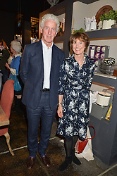 WILLIAM & KATE CORBETT-WINDER at a party to celebrate the publication of Flourish by Willow Crossley held at OKA, 155-167 Fulham Rd, London on 4th October 2016.