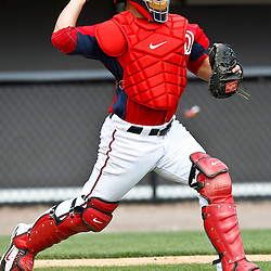 March 4, 2011; Viera, FL, USA; Washington Nationals catcher Jesus Flores (26) during a spring training exhibition game against the Atlanta Braves at Space Coast Stadium.  Mandatory Credit: Derick E. Hingle