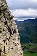 Climber on North West Arete, Gimmer Crag, Langdale, Lake District, Cumbria, England, UK