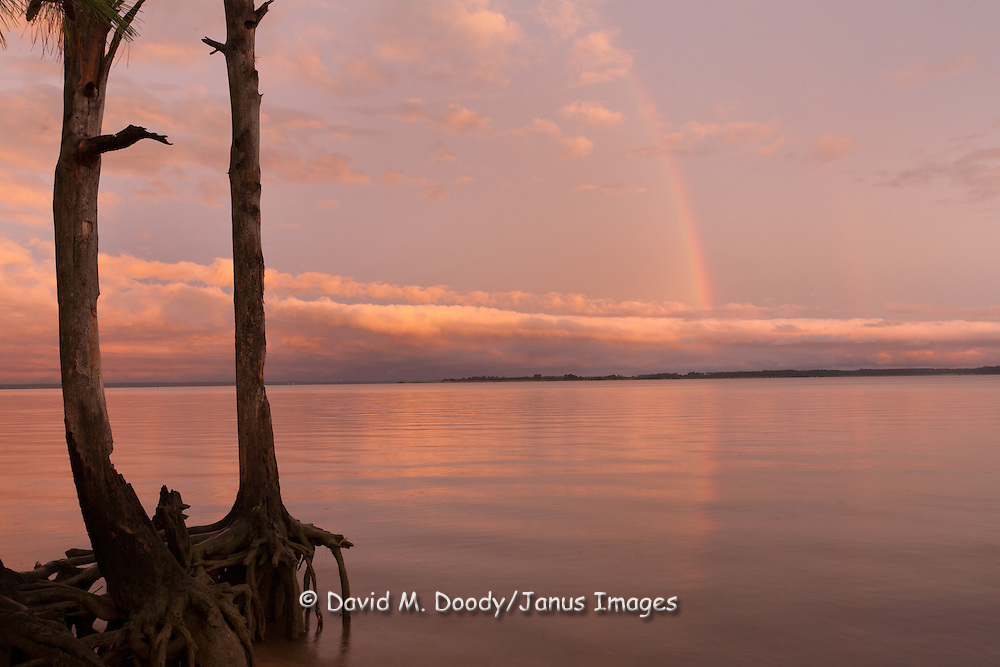 """Scenic clouds at sunset with rainbow over the James River along the Colonial National Parkway between Jamestown and Williamsburg Virginia. Colonial National Historical Park (U.S. National Park Service,) in Virginia's """"Historic Triangle"""""""