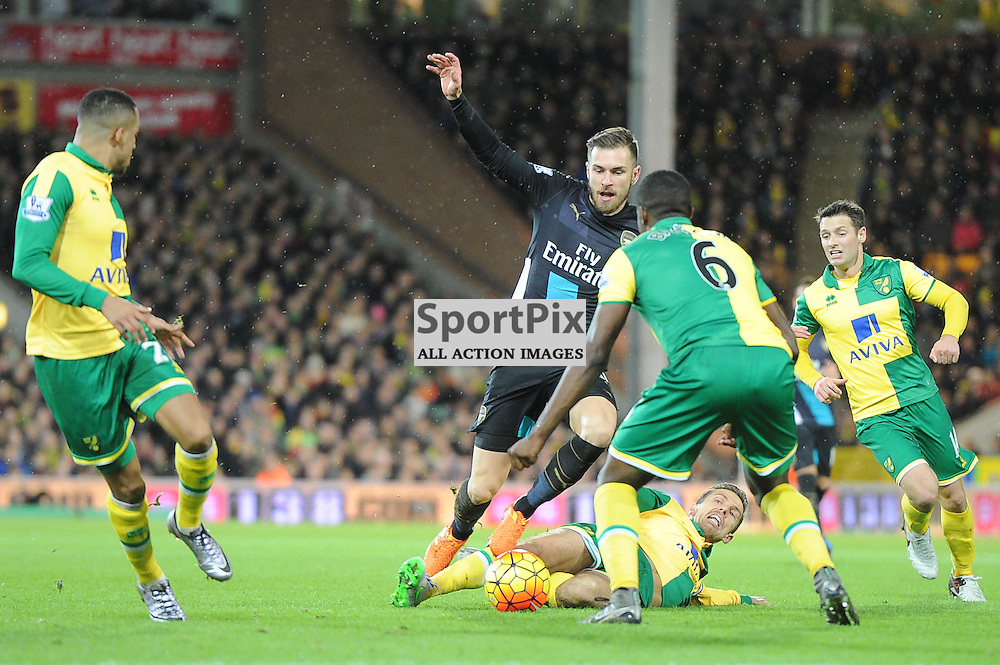 Arsenals Aaron Ramsey is fouled by Norwichs Ryan Bennett during the Norwich v Arsenal game in the Barclays Premier League on Sunday 29th November 2015 at Carrow Road
