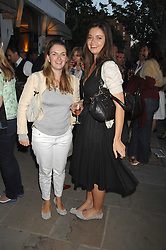 Left to right, sisters LADY SYBILLA HART and LADY NATASHA RUFUS-ISAACS wearing the same style of shoes at the launch of The Rupert Lund Showroom, 61 Chelsea Manor Street, London SW3 on 2nd May 2007.<br /><br />NON EXCLUSIVE - WORLD RIGHTS