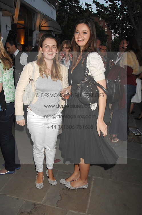 Left to right, sisters LADY SYBILLA HART and LADY NATASHA RUFUS-ISAACS wearing the same style of shoes at the launch of The Rupert Lund Showroom, 61 Chelsea Manor Street, London SW3 on 2nd May 2007.<br />