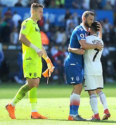 Erik Pieters of Stoke City hugs Leon Britton of Swansea City after the final whistle -Mandatory by-line: Nizaam Jones/JMP- 13/05/2018 - FOOTBALL - Liberty Stadium - Swansea, Wales - Swansea City v Stoke City - Premier League