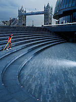 Man throwing javelin on steps of The Scoop amphitheatre London England back view