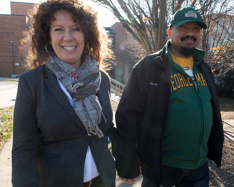 December 5, 2015 - Fairfax, VA - A day in the life of &quot;Doc Nix,&quot; aka Dr. Michael Nickens, the Director of the Athletic Bands for George Mason University. Here Doc Nix meets up with girlfriend Lauren Wagner, who heads up the admissions office at George Mason.<br /> <br /> <br /> Photo by Susana Raab