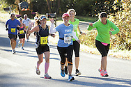 Goshen, New York  - Runners wave as they race in the Hambletonian Marathon on Sunday, Oct. 20, 2013.