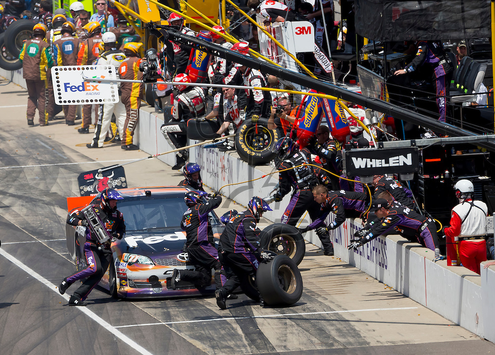 INDIANPOLIS, IN - JUL 29, 2012:  Denny Hamlin (11) races during the Curtiss Shaver 400 presented by Crown Royal at the Indianapolis Motor Speedway in Indianapolis, IN.