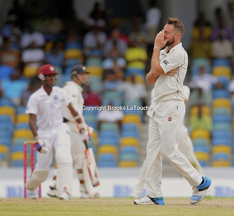 New Zealand bowler Mark Craig disappointed that West Indies batsman Kraigg Brathwaite gets 4 runs during day two of the Third and Final Test West Indies v New Zealand at Kensington Oval, Barbados.<br /> Photo: Randy Brooks/www.photosport.co.nz