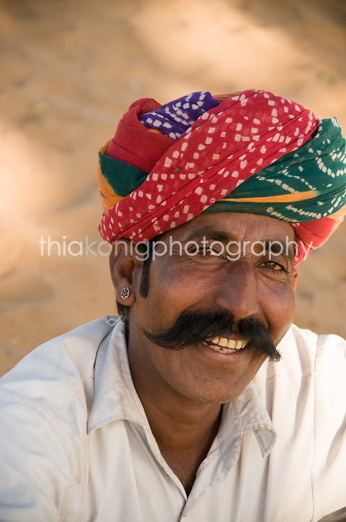 Portrait of man with colored turban and big dark mustache, Pushkar, India