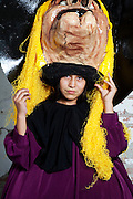 """San Miguel de Allende, Guanajuato, Mexico: 12-year-old Maria Angelica Munoz Espinoza portrays the Snow White Witch. She has been doing this since she was seven. The crazies used to scare her, so she decided to join them. """"The Day of the Crazies,"""" is a carnival during which groups in 4 different neighborhoods in this historical town dress up and dance in the street in honor of San Pasqual Bailon, the dancing saint. The Espinoza family has been creating papier mache heads and costumes for over 30 years; this year celebrating the bad guys in Disney films. 6/15/09 (photo: Ann Summa/Getty Images)."""